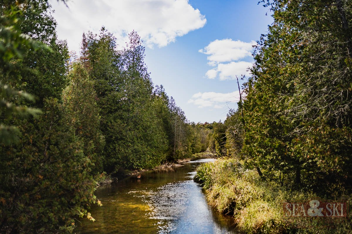 Flowing River that runs through Property Listed by Boutique Real Estate Firm
