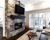 Blue Condo Living Area with Fire Place